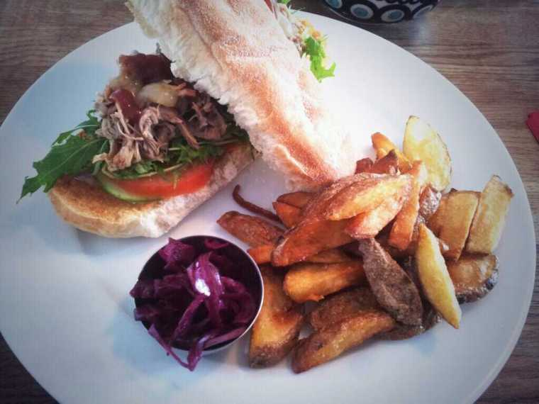 Pulled pork sub with homemade slaw and chips