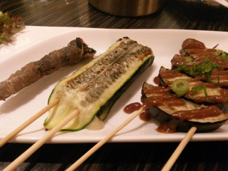 L-R prawn skewer, courgette and cheese skewer & roasted aubergine in miso sauce