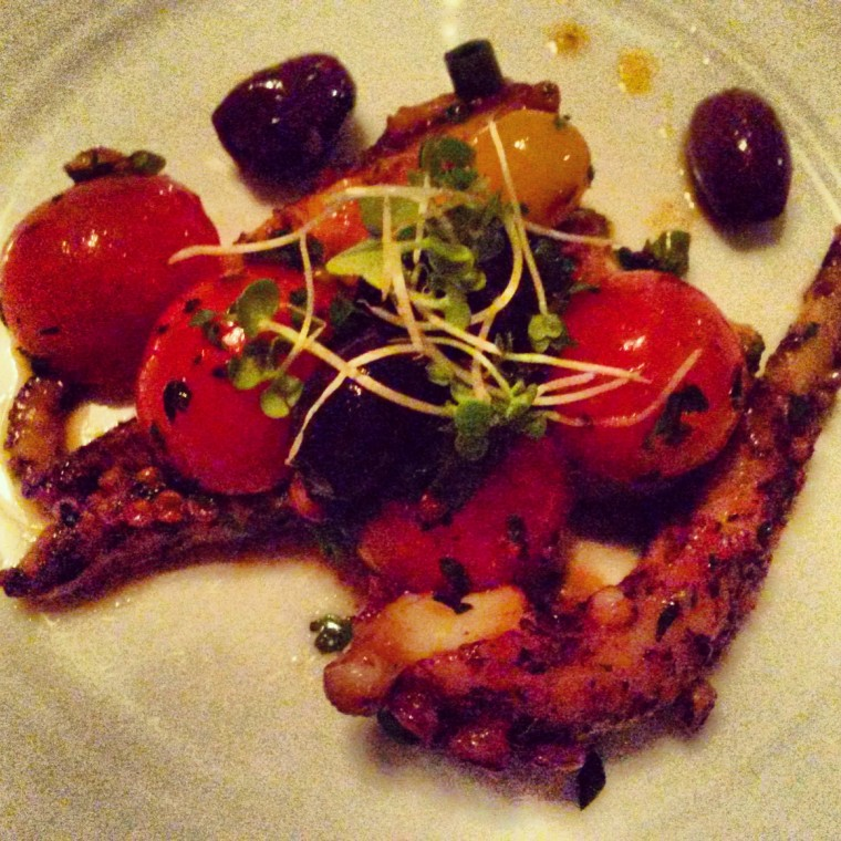 Seared octopus with cherry tomatoes and olives